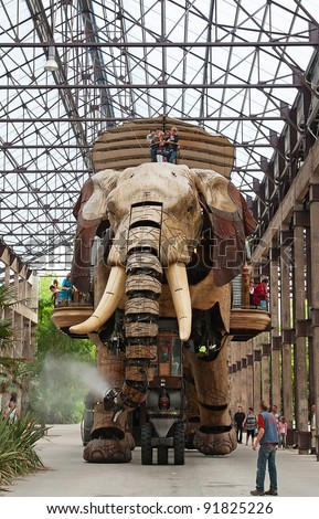 "NANTES - AUGUST 09: The Great Elephant of Nantes on August 09, 2009 in Nantes, France. The 12-metre high gigantic mechanical animal is main attraction of steampunk park ""Les Machines de l'Ile""."