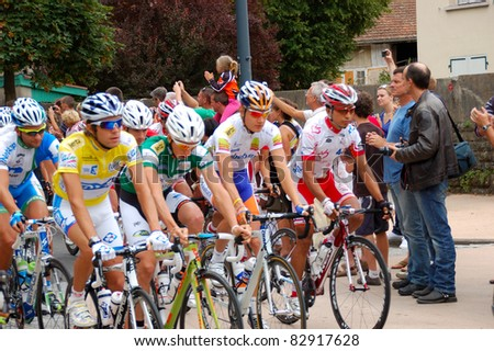 "NANTUA, FRANCE - AUG 12: Professional racing cyclist Thibault Pinot, leader and yellow jersey starting UCI WORLD TOUR "" TOUR DE L'AIN"" stage 3 on August 12, 2011 in Nantua, Ain, France."
