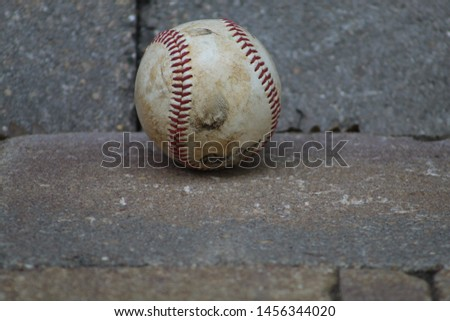 NAPERVILLE,ILLINOIS-JULY 20:A baseball on some stone and some room for text.