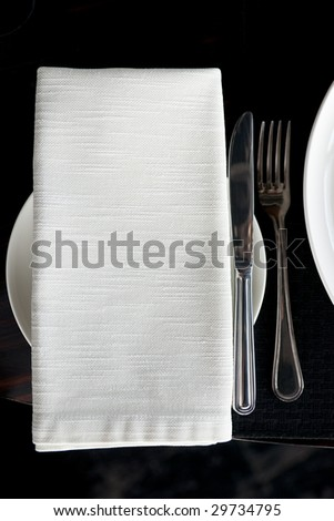 Napkin and silverware on restaurant table