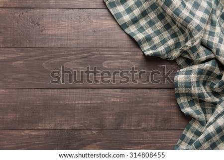 Napkin on the wooden background. Top view.