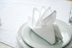 Napkins in the shape of a ship for decoration at a wedding