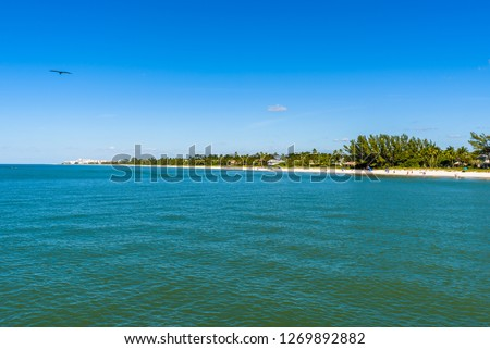 Naples beach with its white sand and turquoise sea on a sunny day seen from the Pier. Florida, United States of America. #1269892882