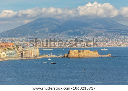 Naples, Italy - built during the 15th century, Castel dell'Ovo (Egg Castle) is a seaside castle located in the Gulf of Naples. Here the fortress with Mount Vesuvius in the background ストックフォト ©