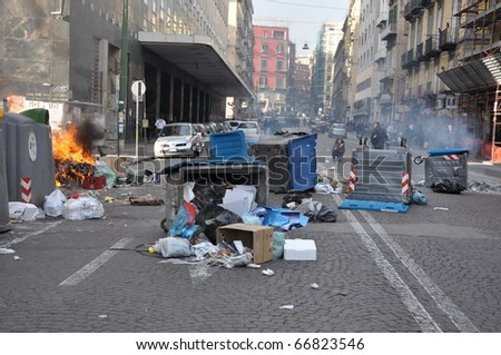 NAPLES, ITALY - DECEMBER 8: fire and violence during a strike in the city of Naples, Italy on December 8, 2010. the demonstration involved students against the Italian government