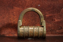 Naples, Italy. January 5th, 2011. Old padlock dating from the nineteenth century, made of brass. Padlock with letter combination security system.