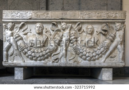 NAPLES, ITALY - JULY 22 2015: Ancient Roman sarcophagus on display in the Naples National Archaeological Museum. Elaborately carved sarcophagi were characteristic from the 2nd to the 4th centuries AD #323715992