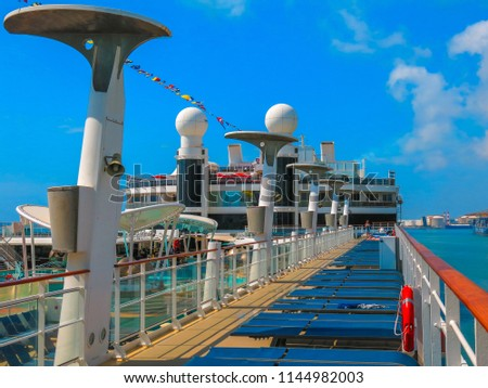 Naples, Italy. July 2nd, 2014. Sun chairs and a jogging track on the top deck of Norwegian Cruise Line Epic. Taken while docked on a sunny day.  #1144982003