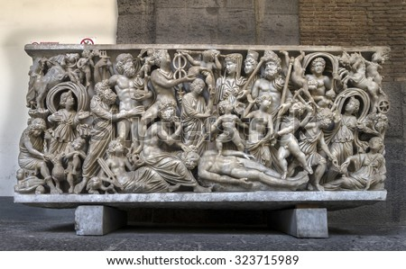 NAPLES, ITALY - JULY 22 2015: 4th century AD Roman sarcophagus depicting the legend of Prometheus creating the first man on display in the Naples National Archaeological Museum. #323715989