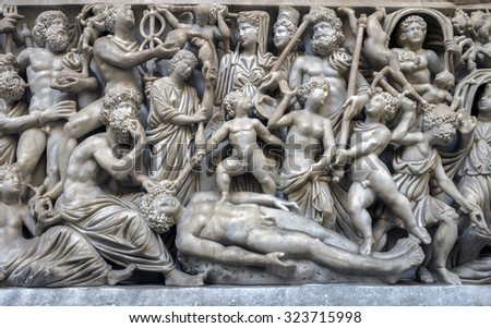 NAPLES, ITALY - JULY 22 2015: 4th century AD Roman sarcophagus depicting the legend of Prometheus creating the first man on display in the Naples National Archaeological Museum. #323715998