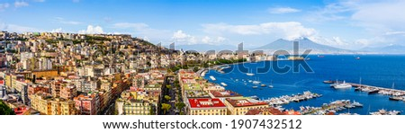 Naples, Italy: Panoramic view of the city and port with Mount Vesuvius on the horizon as  seen from the hills of Posilipo. Seaside landscape of the city harbor and golf on the Tyrrhenian Sea Stock fotó ©