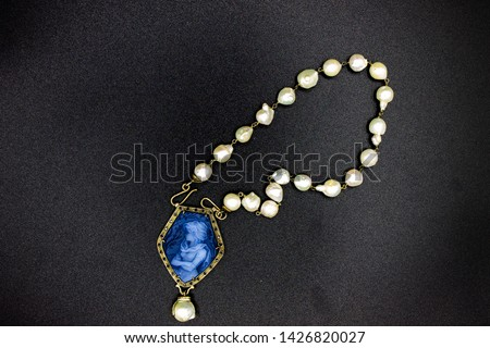 Naples Italy. Pearl necklace with blue coral pendant also called cameo, depicting a stately woman. #1426820027