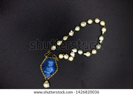 Naples Italy. Pearl necklace with blue coral pendant also called cameo, depicting a stately woman. #1426820036