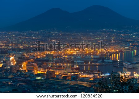 NAPLES, ITALY - SEPTEMBER 28: The Port of Naples has an annual traffic capacity of 25 million tons of cargo on September 28, 2012 in Naples. It is one of the largest Italian seaports of the area.