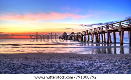 Naples Pier on the beach at sunset in Naples, Florida, USA