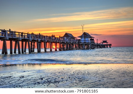 Naples Pier on the beach at sunset in Naples, Florida, USA Stock fotó ©