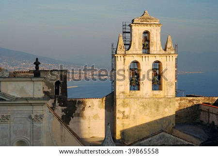 Naples port and castle bell tower