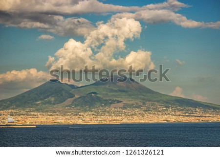 Naples, seen from posillipo on the,  semi covered by white clouds, vulcano vesuvius