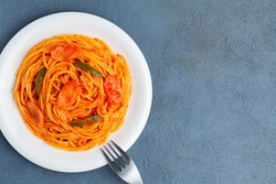Napolitan spaghetti and blue background