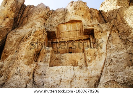 Naqsh-e Rostam is an ancient necropolis located about 12 km northwest of Persepolis, in Fars Province, Iran, with a group of ancient Iranian rock reliefs cut into the cliff Stock photo ©