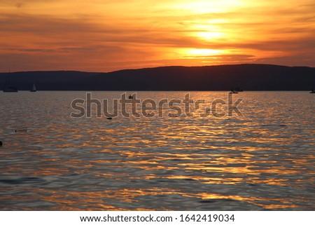 narancssárga napnyugta víz felhők tájkép Stock fotó ©