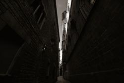 Narrow alley in Gothic Quarter in Barcelona Spain