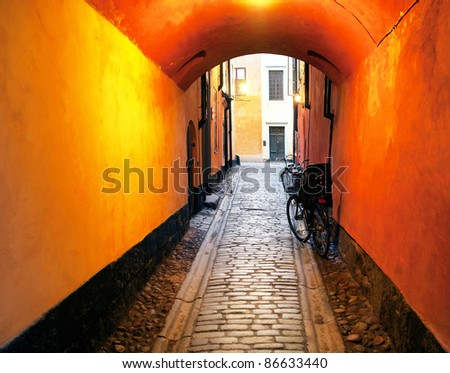 Narrow alley with archway in the Old Town of Stockholm, sweden