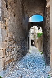 Narrow Alley with Old Buildings in French City of Viviers