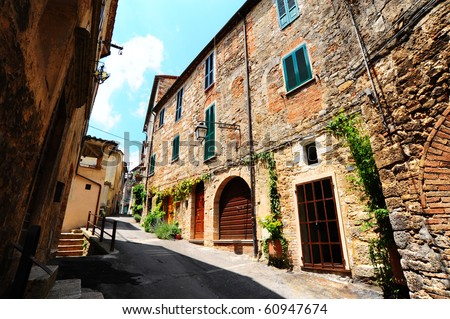 Narrow Alley With Old Buildings In Italian City