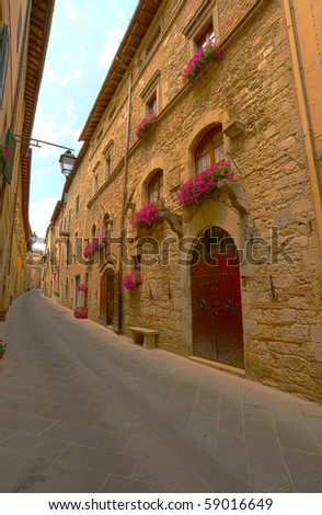 Narrow Alley With Old Buildings In Italian City of Siena