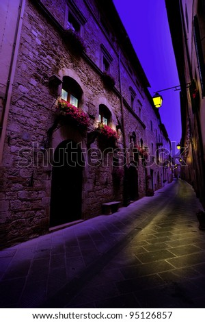 Narrow Alley With Old Buildings In Italian City of Siena at Midnight