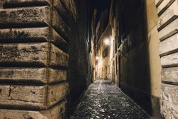 Narrow alleyway in Rome at night. Mystery atmosphere