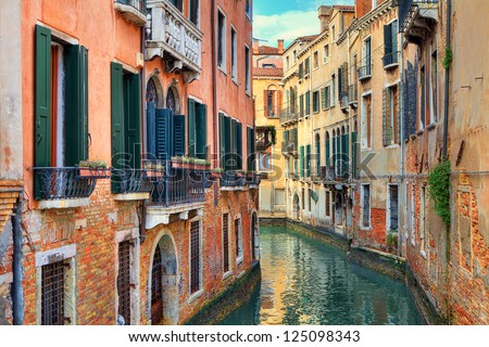 narrow canal among old colorful ...