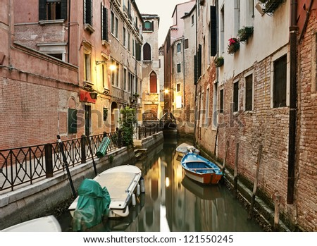 Narrow canal at early morning in Venice, Italy.