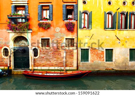 Narrow canal with boat in Venice, Italy