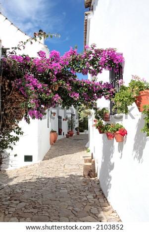 Narrow, cobbled streets and pretty houses of Spanish Pueblo at Castillo de la Frontera in Andalucia southern Spain