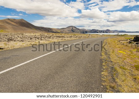 Narrow country asphalt route in Iceland.