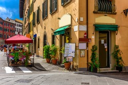 Narrow cozy street in Pisa, Tuscany, Italy. Architecture and landmark of Pisa. Cityscape of Pisa