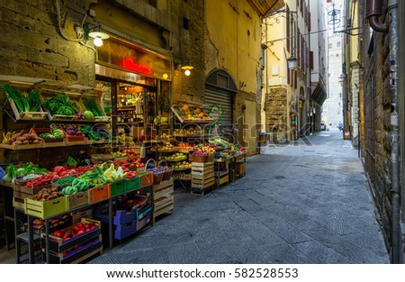 Narrow cozy street with vegetable shop in Florence, Tuscany, Italy. Architecture and landmark of Florence, Florence cityscape #582528553