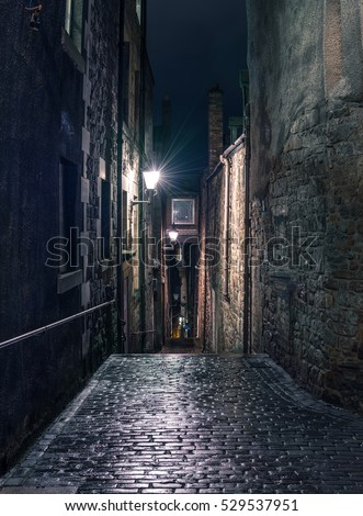 Narrow dark alleyway in Edinburgh at night #529537951