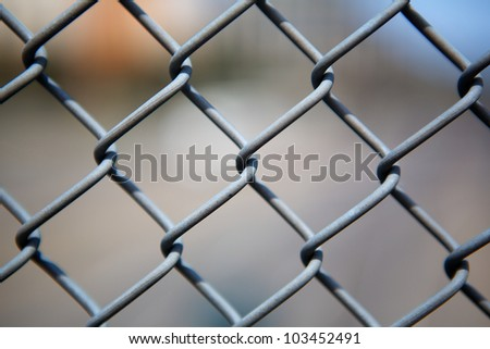 Narrow Dept of Field close up image of chain link fence #103452491