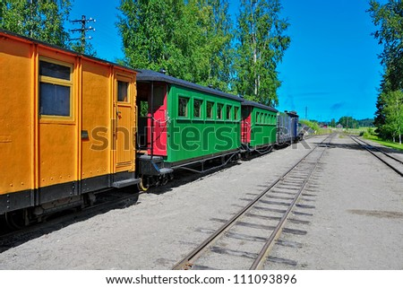 Narrow-gauge steam locomotive with an empty passenger car at the old station. Minkio, Finland