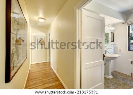 Narrow hallway with hardwood floor and ivory walls exit for Small hallway bathroom ideas