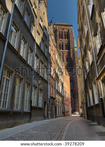Narrow historic street in Gdansk, overlooking the St. Mary's Basilica, Poland.