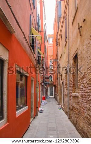Narrow lane between two old buildings in Venice