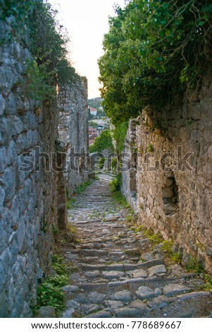 Narrow lane in old town fortress ruins in Stari Bar in Montenegro.