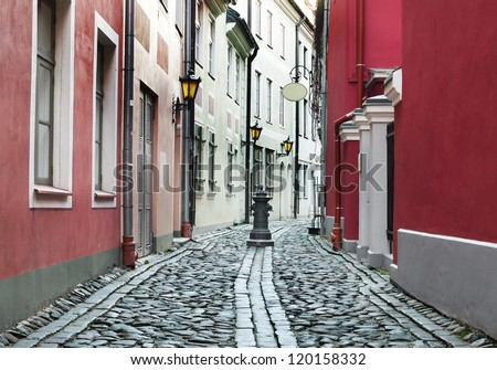Narrow medieval street in old Riga, Latvia. In 2014, Riga city is the European capital of culture