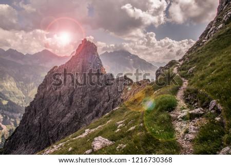 Narrow Mountain Path along a Steep Slope #1216730368