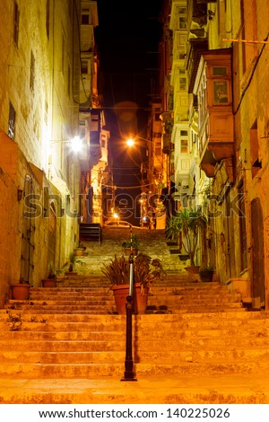 narrow old street and stairs in Valletta in a warm summer night