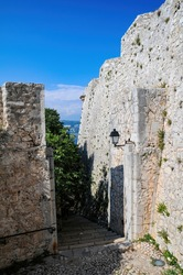 Narrow pass along of Fort Royal wall on Sainte-Marguerite Island near Cannes. Lerins Islands, French Riviera, France.